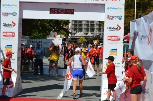 Sue Edney crosses line at Penticton Challenge